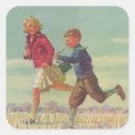 Niños del vintage que corren a los libros que pegatinas cuadradas