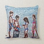niños en el bosquejo de la playa que juega en cojin