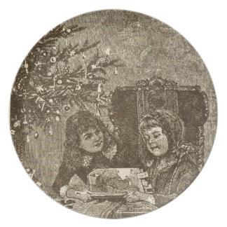 niños en la placa del navidad platos de comidas