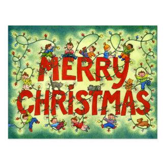 Niños en las luces de navidad - postal del navidad