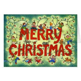 Niños en las luces de navidad - tarjeta de
