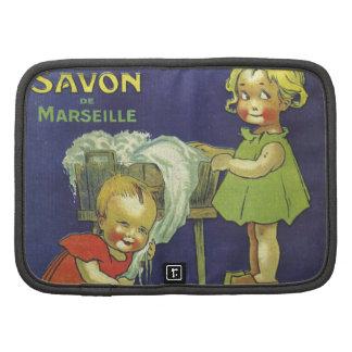 Niños franceses L'amande del anuncio de la Planificador
