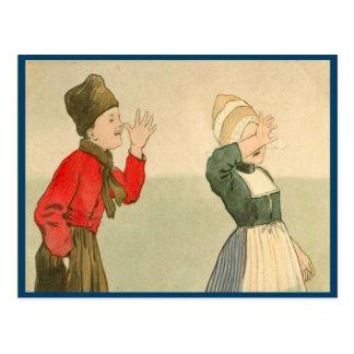 Niños holandeses del vintage en traje nacional postal