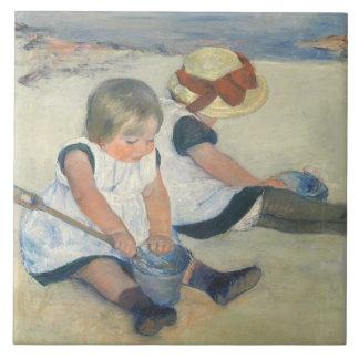 Niños que juegan en la playa, 1884 teja