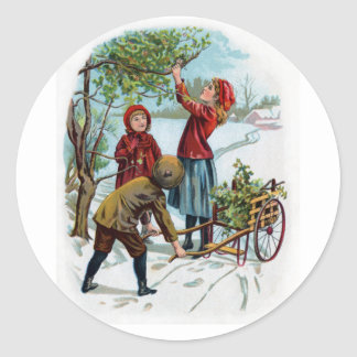 Niños que recogen acebo en invierno pegatina redonda