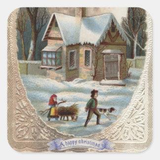 Niños que recogen la madera en un trineo pegatina cuadrada