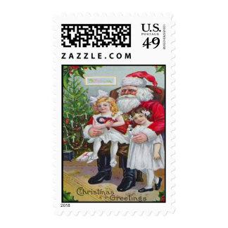 Niños que se sientan en el revestimiento de Santa Sello Postal