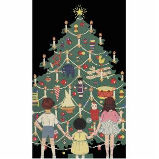 Niños y árbol de navidad - ejemplo del vintage escultura fotografica