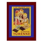 Niños y barra de chocolate franceses lindos