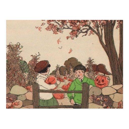 Niños y calabazas del guión del vintage postal