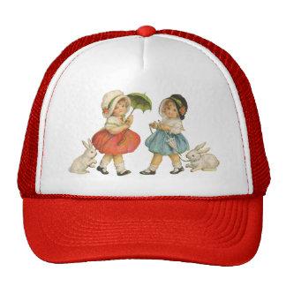 Niños y conejos del vintage gorra
