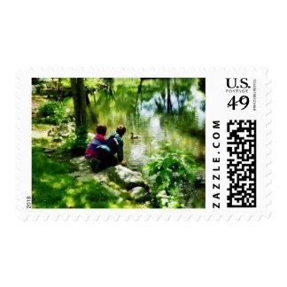 Niños y patos en parque sellos postales
