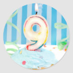 Ninth birthday candles on frosted cake in blue classic round sticker
