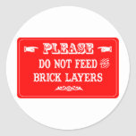 No alimente a las capas de ladrillo etiqueta