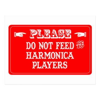 No alimente a los jugadores de la armónica tarjetas postales