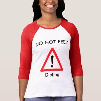 No alimente - en una dieta playera
