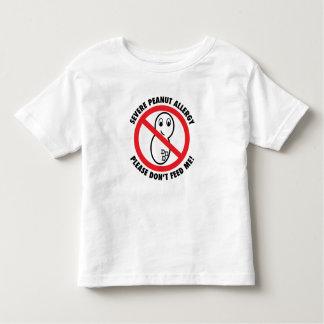 No alimente por favor la camiseta del niño de la camisas