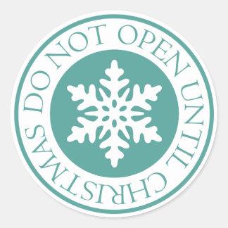 No se abra hasta verde azul del copo de nieve del pegatina redonda