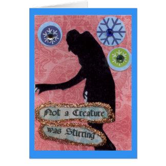 No una criatura revolvía tarjeta de felicitación