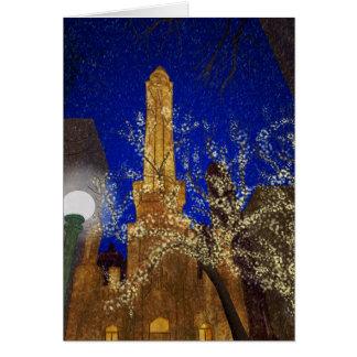 Noche del invierno en la torre de agua tarjetón