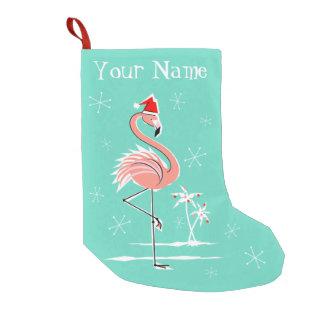Nombre del flamenco del navidad que almacena uno calcetín de navidad pequeño