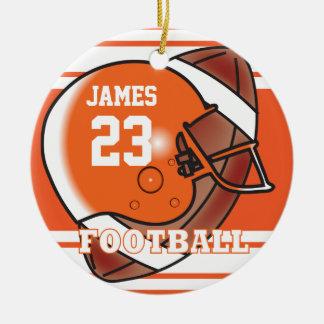 Nombre y número anaranjados y blancos del fútbol adorno navideño redondo de cerámica
