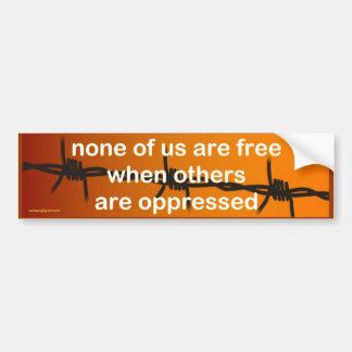 none of us are free... bumper sticker