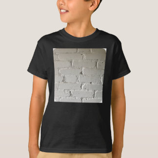 nooks and crannies white brick wall T-Shirt