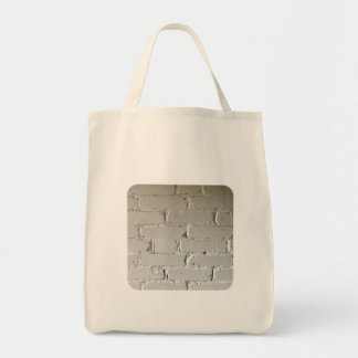 nooks and crannies white brick wall tote bag