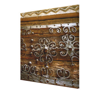 Norman iron scroll work on wooden door canvas print