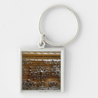 Norman iron scroll work on wooden door Silver-Colored square keychain