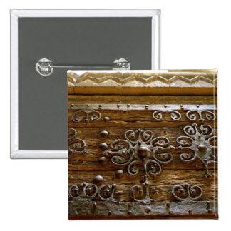 Norman iron scroll work on wooden door pinback button