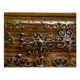 Norman iron scroll work on wooden door postcard