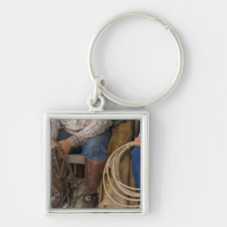 North America, USA. Cowboys relaxing and 2 Key Chain