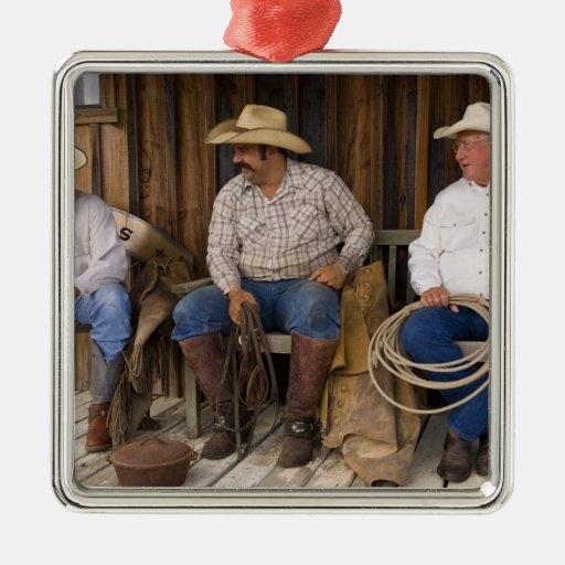 North America, USA. Cowboys relaxing and Christmas Tree Ornaments