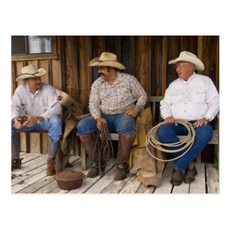 North America, USA. Cowboys relaxing and Postcard