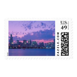 North America, USA, IL. Chicago skyline at dusk Postage