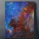 """North American Nebula continent NASA Plaque<br><div class=""""desc"""">The North American nebula combines both visible and infrared light observations, taken by the Digitized Sky Survey and NASAs Spitzer Space Telescope. The nebula is named after its resemblance to North America in blue hues. Infrared light, displayed here in red and green, can penetrate deep into the dust, revealing multitudes...</div>"""