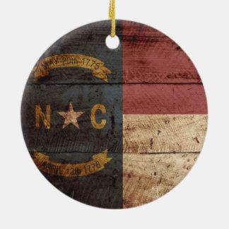 North Carolina State Flag on Old Wood Grain Ceramic Ornament