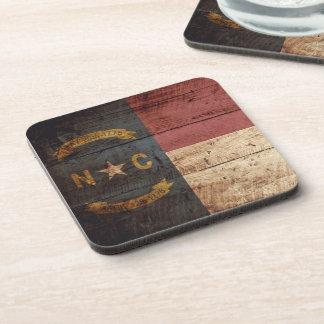 North Carolina State Flag on Old Wood Grain Drink Coaster