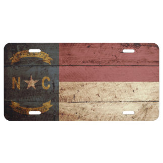 North Carolina State Flag on Old Wood Grain License Plate