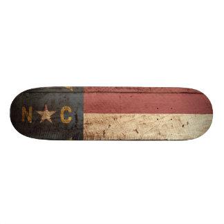 North Carolina State Flag on Old Wood Grain Skateboard Deck