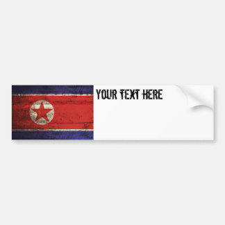North Korea Flag on Old Wood Grain Bumper Sticker