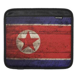 North Korea Flag on Old Wood Grain Sleeves For iPads