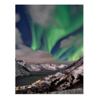 northern lights over winter landscape postcard