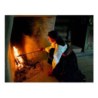 Norwegian Woman Tending the Hearth Fire Postcard