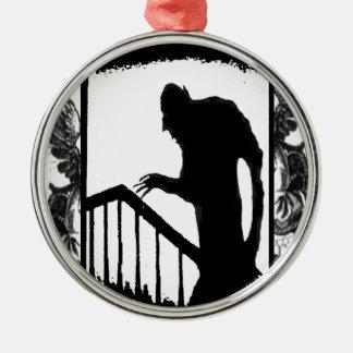 Nosferatu-shadow on the stairs round metal christmas ornament