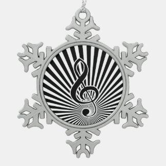Nota blanco y negro de la música del Clef sobre Adorno De Peltre En Forma De Copo De Nieve