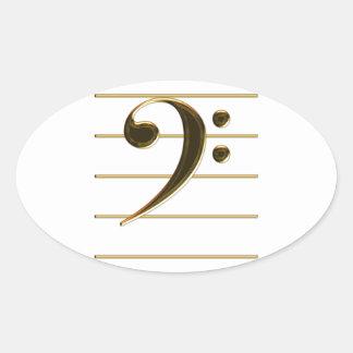 Nota de la música del Clef bajo del oro Pegatina Ovalada
