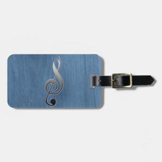 Nota de madera azul abstracta del clef de la etiquetas para maletas
